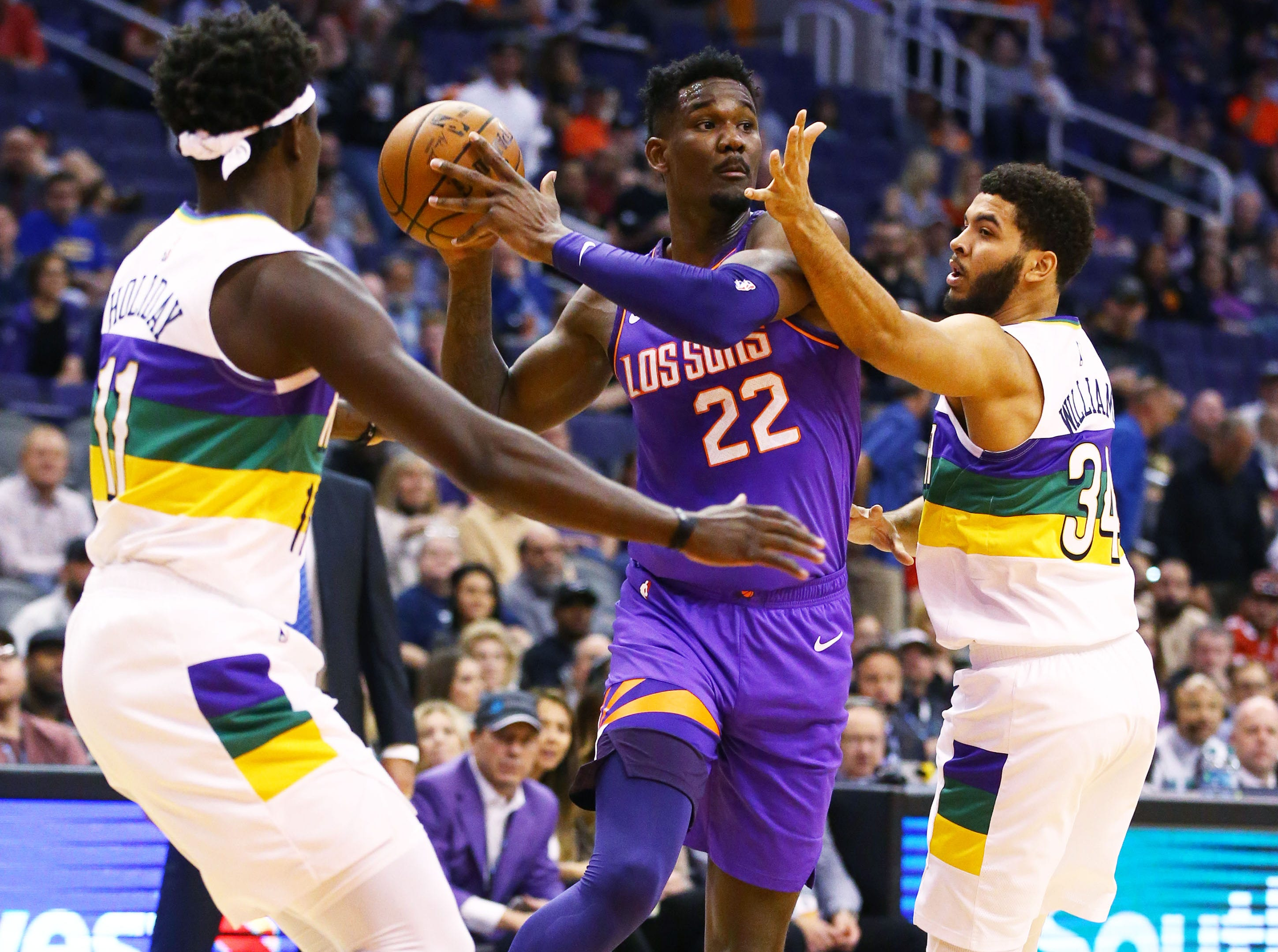 Phoenix Suns center Deandre Ayton is double teammed by the New Orleans Pelicans in the first half on Mar. 1, 2019, at Talking Stick Resort Arena in Phoenix, Ariz.