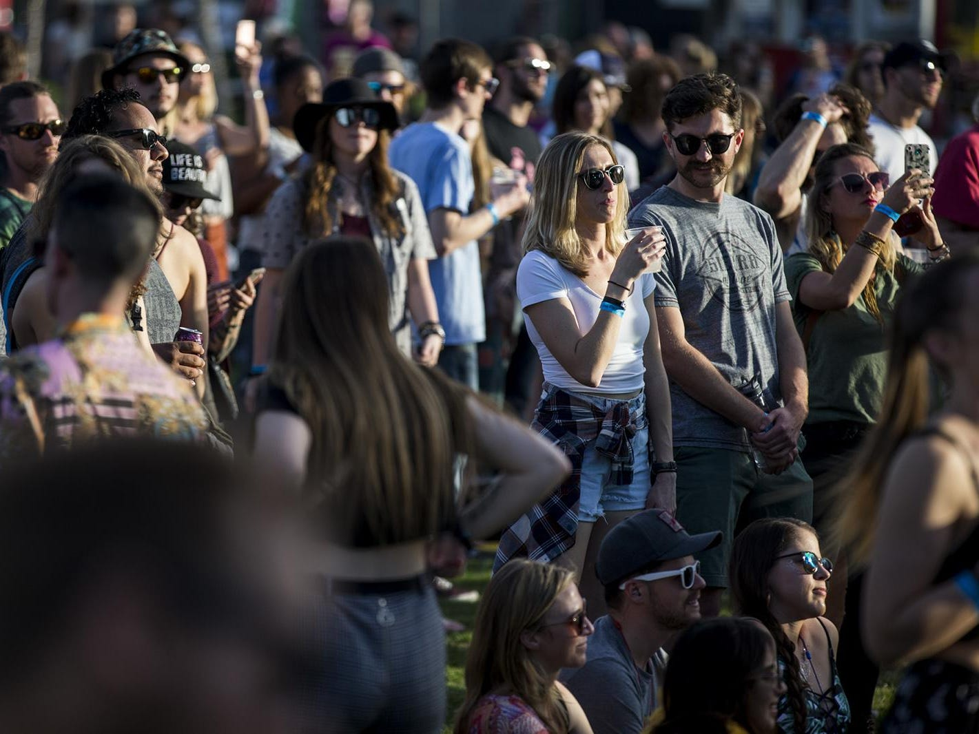 Fans listen to The Hip Abduction perform during McDowell Mountain Music Festival on Friday, March 1, 2019, at Margaret T. Hance Park in Phoenix.