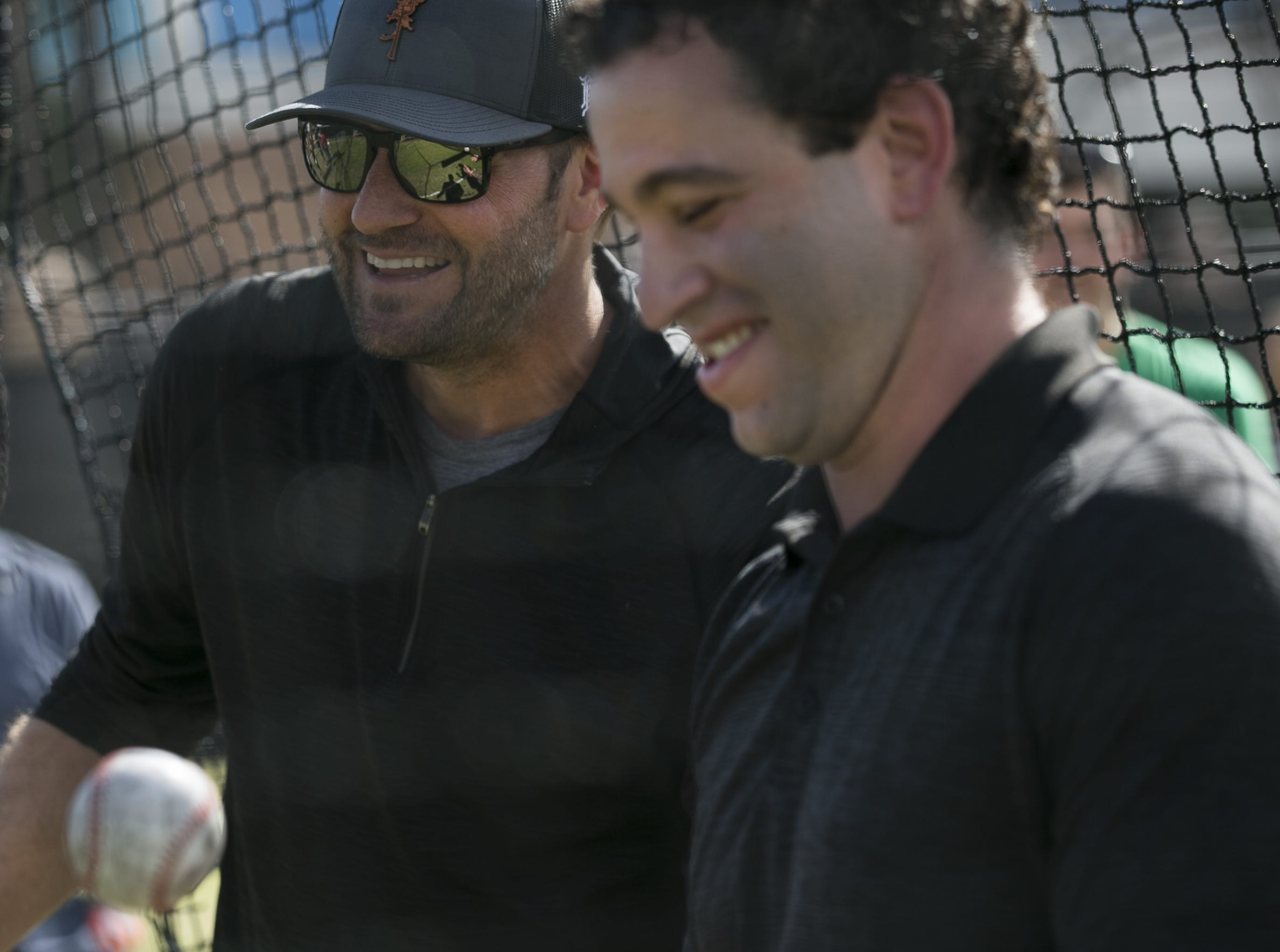 Former MLB pitcher Shawn Estes (left) shows fans pitching techniques at the Innings Festival at Tempe Beach Park on Saturday, March 2, 2019.