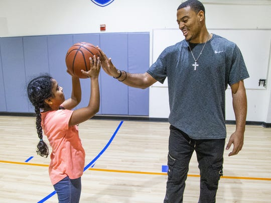 Mimi Sommers is the owner and director of DreamTeam Academy Scottsdale, a learning facility for children who want to learn basketball. Sruti Nall, 9, gets some encouragement from JeVon Estelle, the athletic director and head trainer.