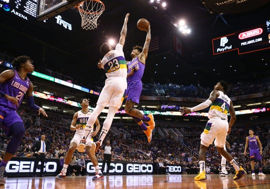 Phoenix Suns forward Kelly Oubre Jr. drives to the basket against New Orleans Pelicans Anthony Davis in the first half on Mar. 1, 2019, at Talking Stick Resort Arena in Phoenix, Ariz.