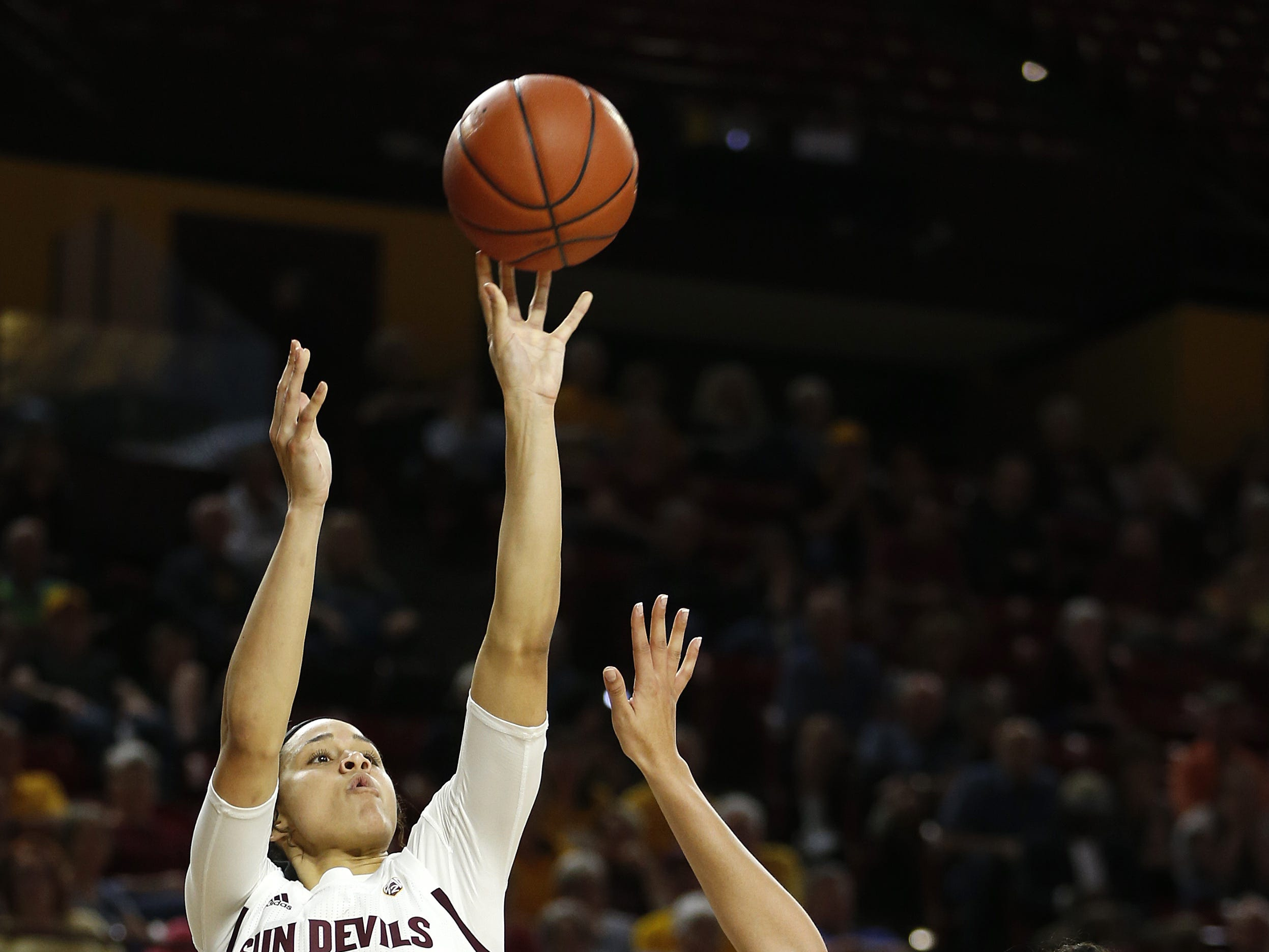 ASU's Kianna Ibis (42) hits a shot over Oregon State's Taya Corosdale (5) during the second half at Wells Fargo Arena in Tempe, Ariz. on March 1, 2019.
