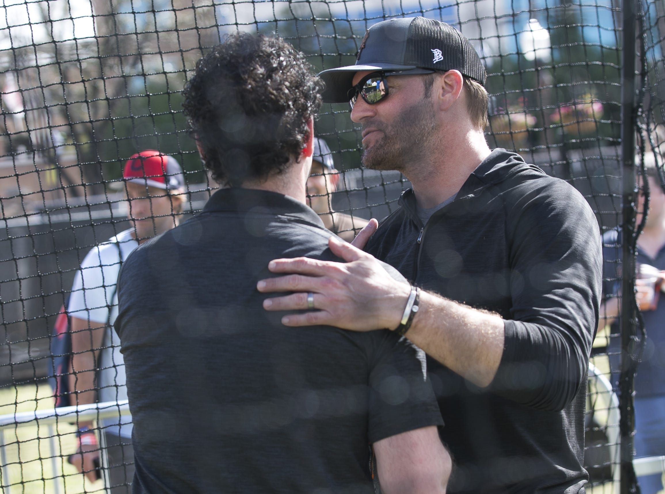 Former MLB pitcher Shawn Estes (right) shows fans pitching techniques at the Innings Festival at Tempe Beach Park on Saturday, March 2, 2019.