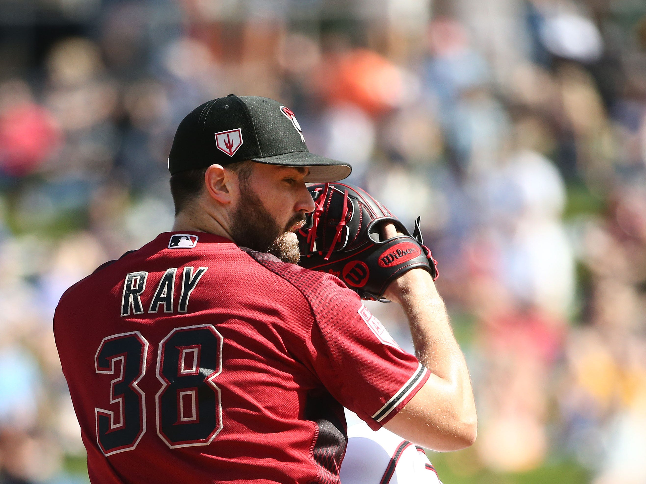 Arizona Diamondbacks pitcher Robbie Ray throws to the Chicago Cubs in the second inning during a spring training game on Mar. 1, 2019 at Salt River Fields in Scottsdale, Ariz.