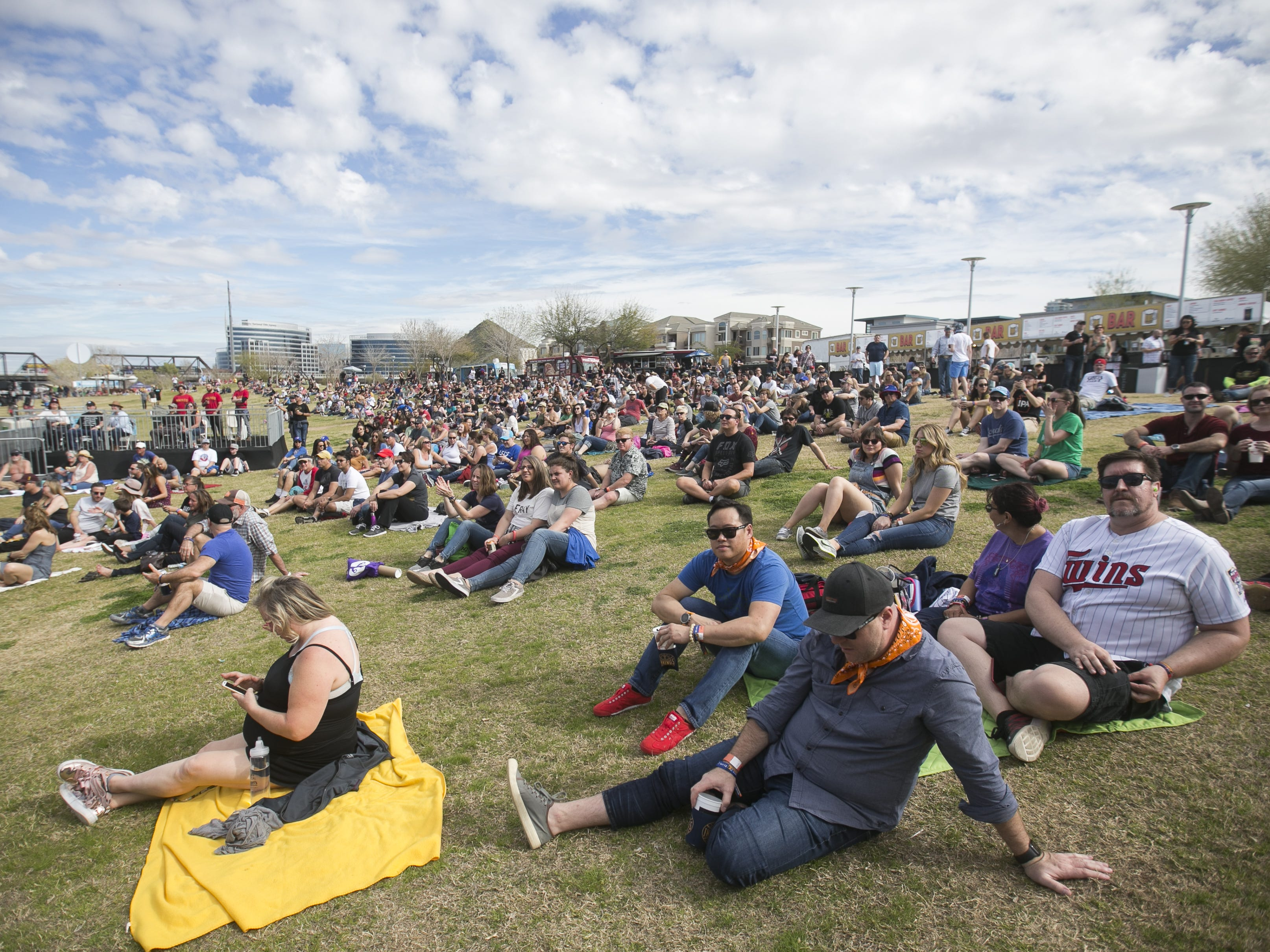 Festival goers watch Black Pistol Fire perform at the Innings Festival at Tempe Beach Park on Saturday, March 2, 2019.