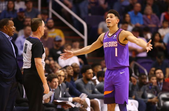 Phoenix Suns guard Devin Booker reacts after a foul against the New Orleans Pelicans in the first half on Mar. 1, 2019, at Talking Stick Resort Arena in Phoenix, Ariz.