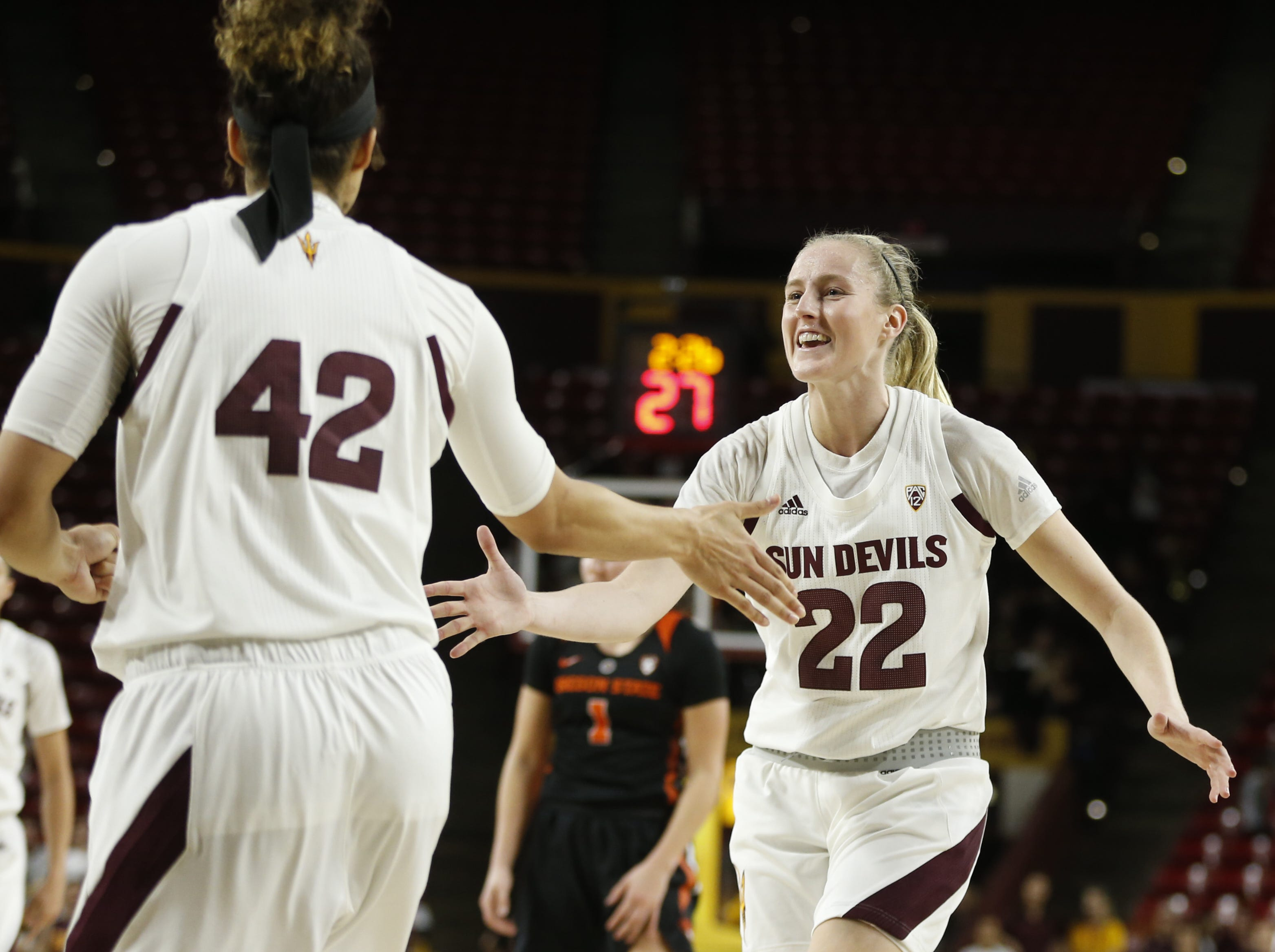 ASU's Courtney Ekmark (22) celebrates with Kianna Ibis (42) after Ibis scored and drew a foul against Oregon State during the second half at Wells Fargo Arena in Tempe, Ariz. on March 1, 2019.