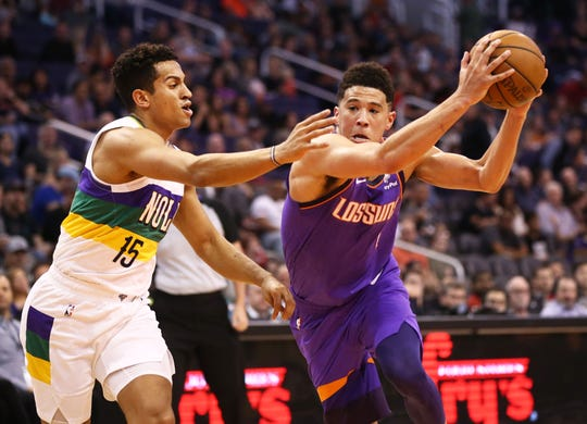 Phoenix Suns guard Devin Booker drives to the basket against New Orleans Pelicans Frank Jackson in the first half on Mar. 1, 2019, at Talking Stick Resort Arena in Phoenix, Ariz.