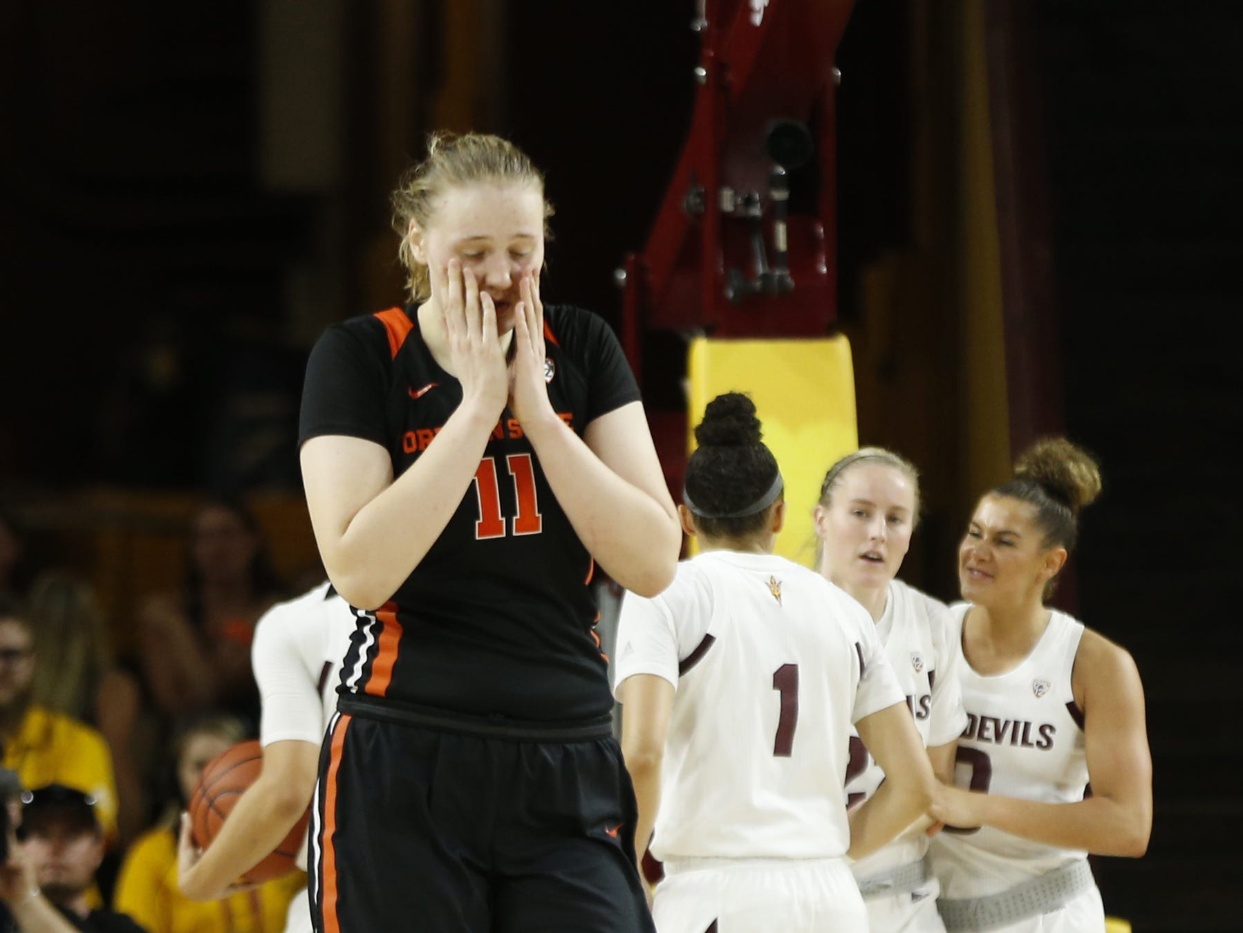 Oregon State's Joanna Grymek (11) reacts after being called for a foul against ASU during the first half at Wells Fargo Arena in Tempe, Ariz. on March 1, 2019.