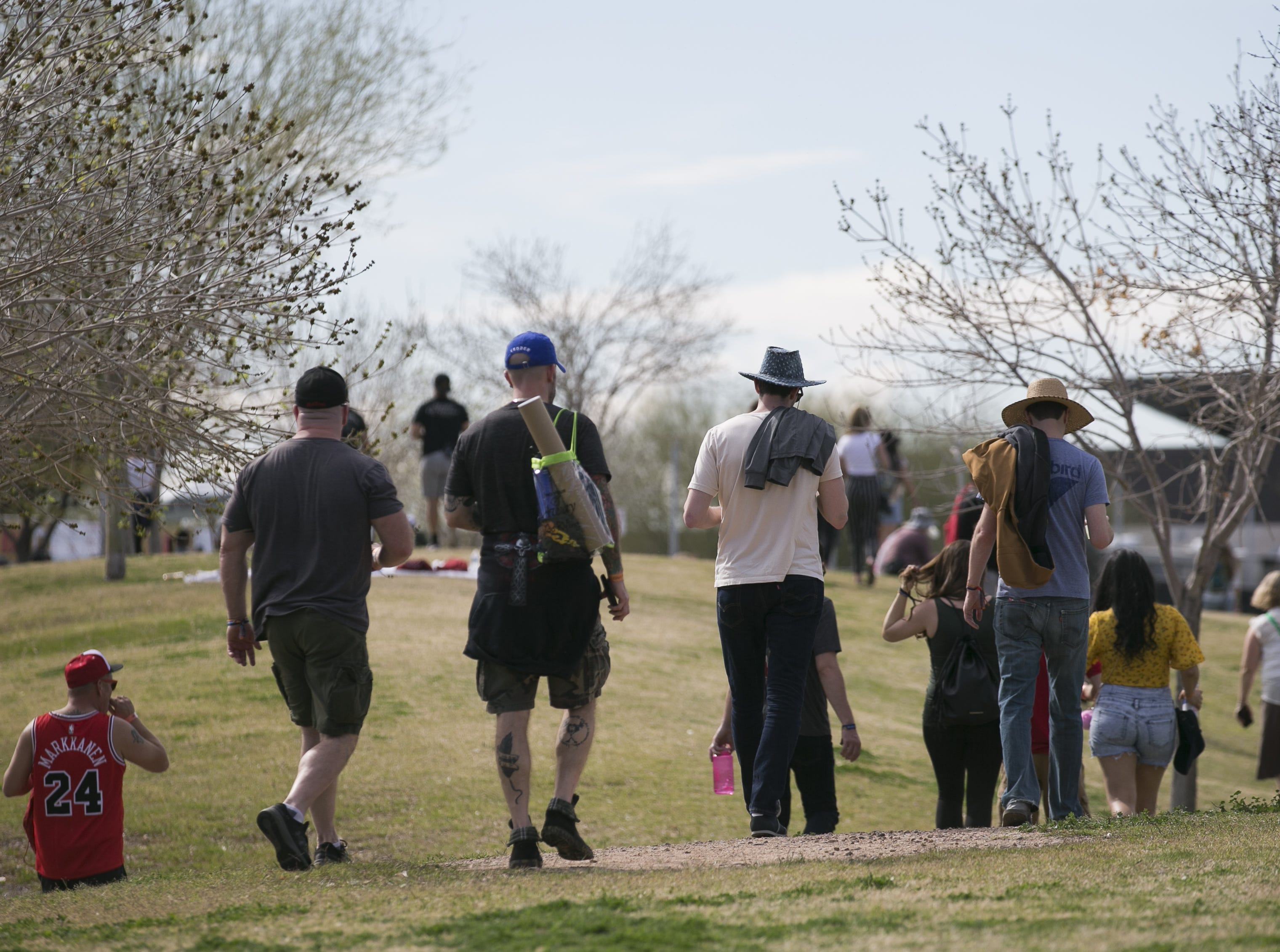 Festival goers walk through the Innings Festival at Tempe Beach Park on Saturday, March 2, 2019.