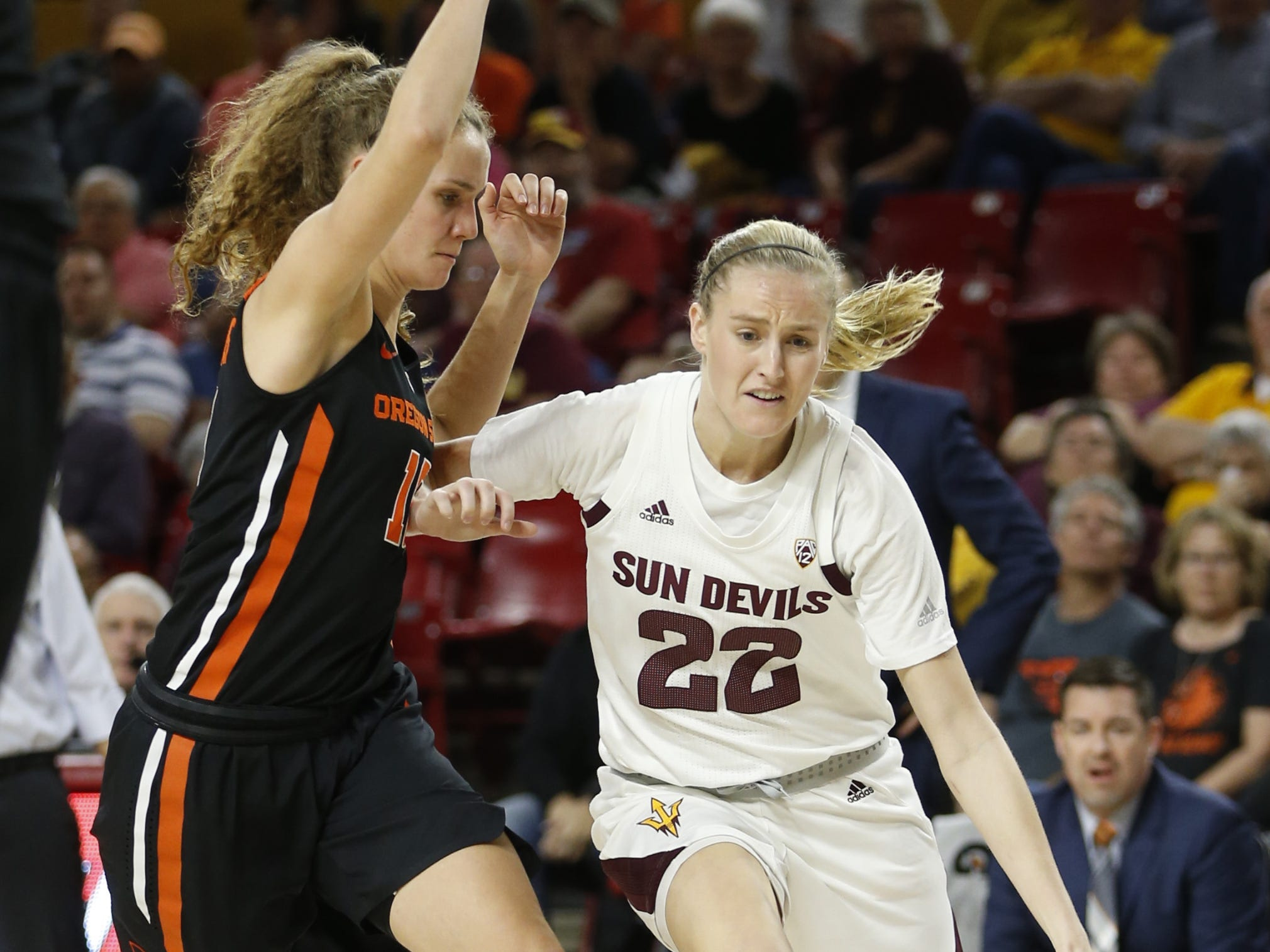 ASU's Courtney Ekmark (22) dribbles against Oregon State's Katie McWilliams (10) during the first half at Wells Fargo Arena in Tempe, Ariz. on March 1, 2019.