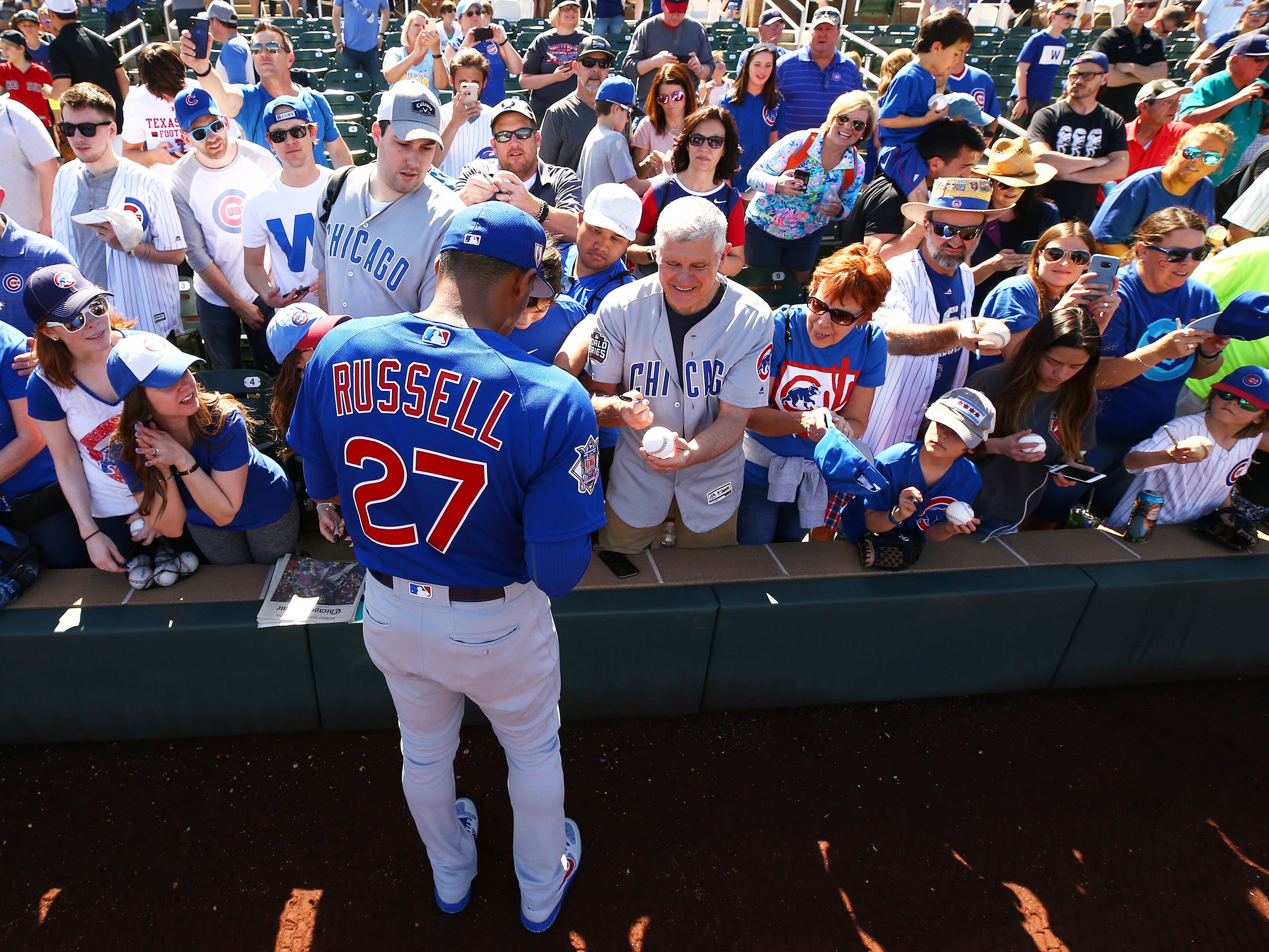 Chicago Cubs shortstop Addison Russell signs autographs before playing the Arizona Diamondbacks during a spring training game on Mar. 1, 2019 at Salt River Fields in Scottsdale, Ariz.