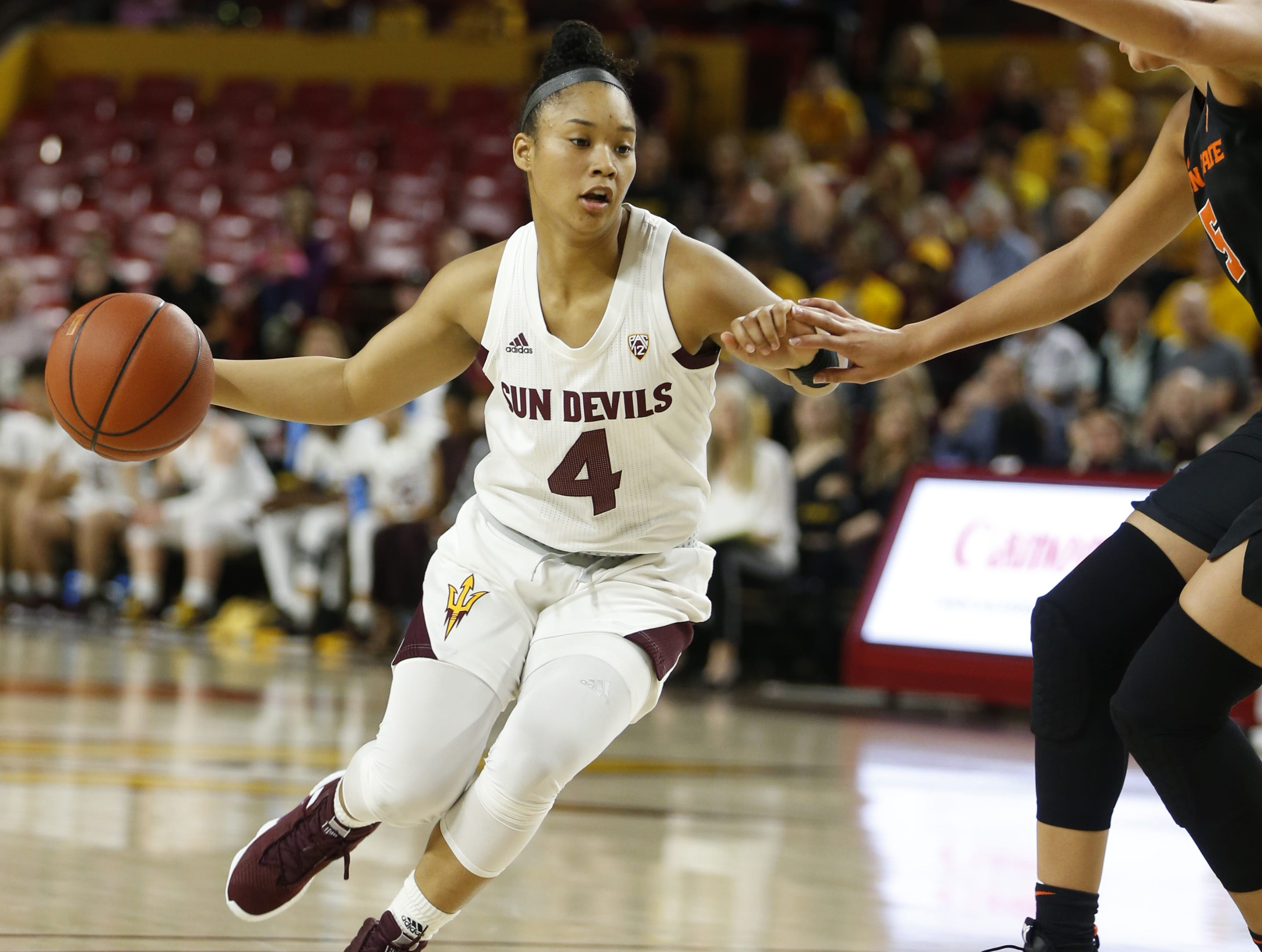 ASU's Kiara Russell (4) dribbles against Oregon State's Taya Corosdale (5) during the first half at Wells Fargo Arena in Tempe, Ariz. on March 1, 2019.