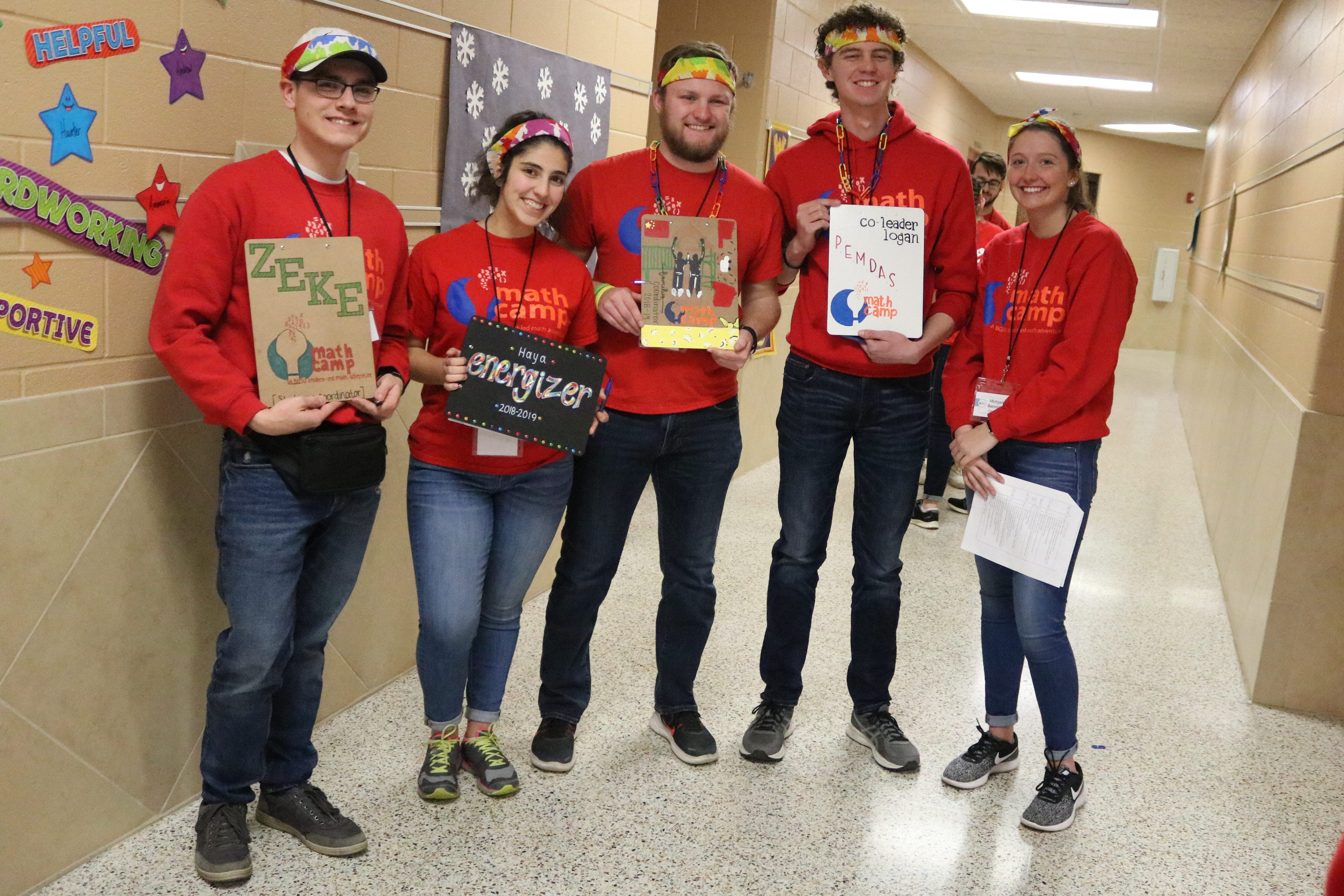 Zeke Ferrell, Haya Saadeh, Nick Drown, Logan Selby, Morgan Bannister, each education students at Bowling Green State University, are the lead organizers of the Math Camp program, which visited Green Springs Elementary on Saturday.