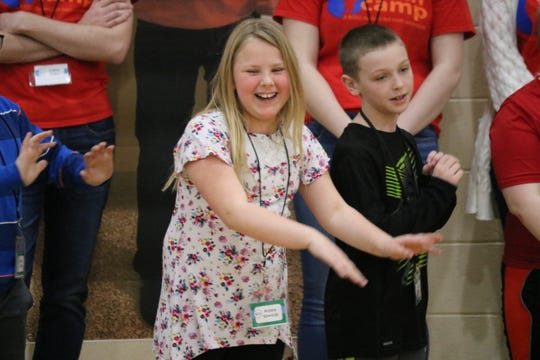 "Keyara Edwards, a student at Green Springs Elementary, performs a dance to get energized during ""Math Camp"" on Saturday."