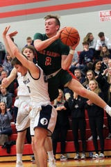Oak Harbor's Jac Alexander looks to pass against Carey.