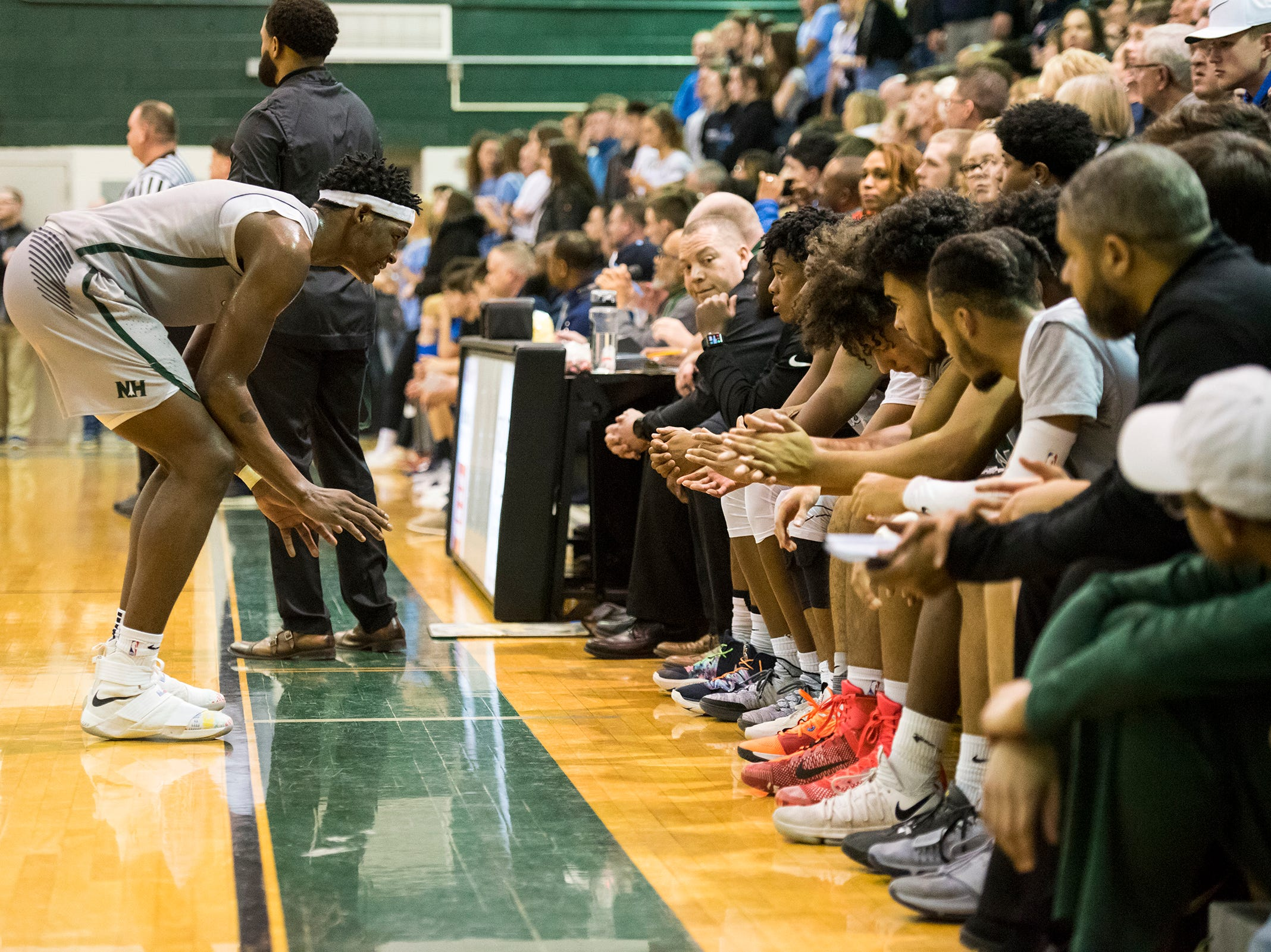 New Haven forward Romeo Weems (left) talks to the team during the MHSAA Division 2 Boys Basketball District Finals against Richmond High School Friday, March 1, 2019 at New Haven High School.