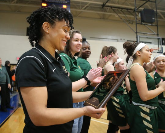 FDR head coach Jessica Paden holds the championship plaque after defeating Saugerties 60-46 in the girls Section 9 Class A section final basketball game on March 1.