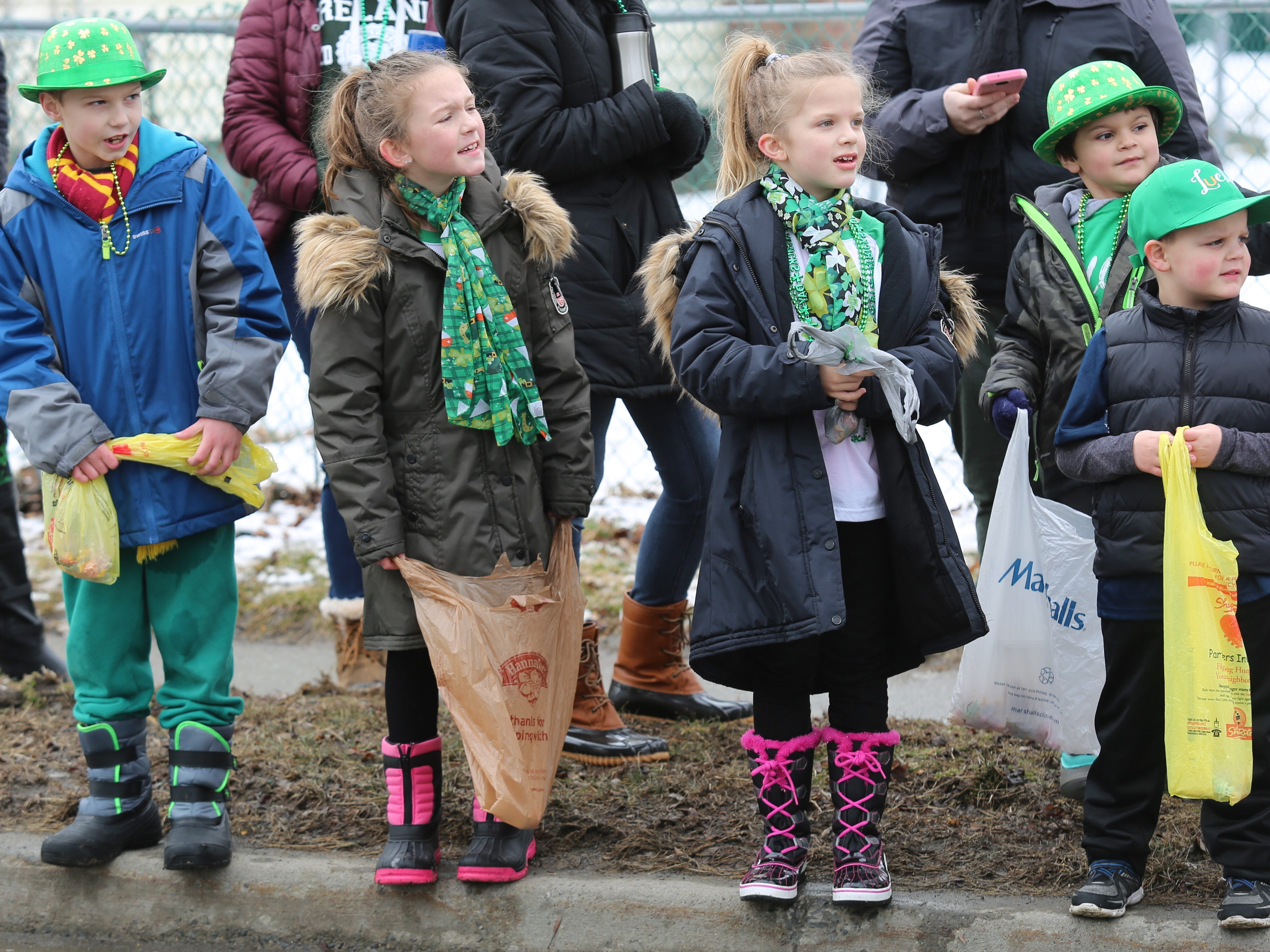 (from left to right) Derek Cogan, 8, Aubrey Cerone, 9, Braelynn Cerone, 7, Jaxson Torres, 4, and Ryan Knapp, 5, watch the Dutchess County St. Patrick's Day Parade pass by in Wappingers Falls on Saturday.
