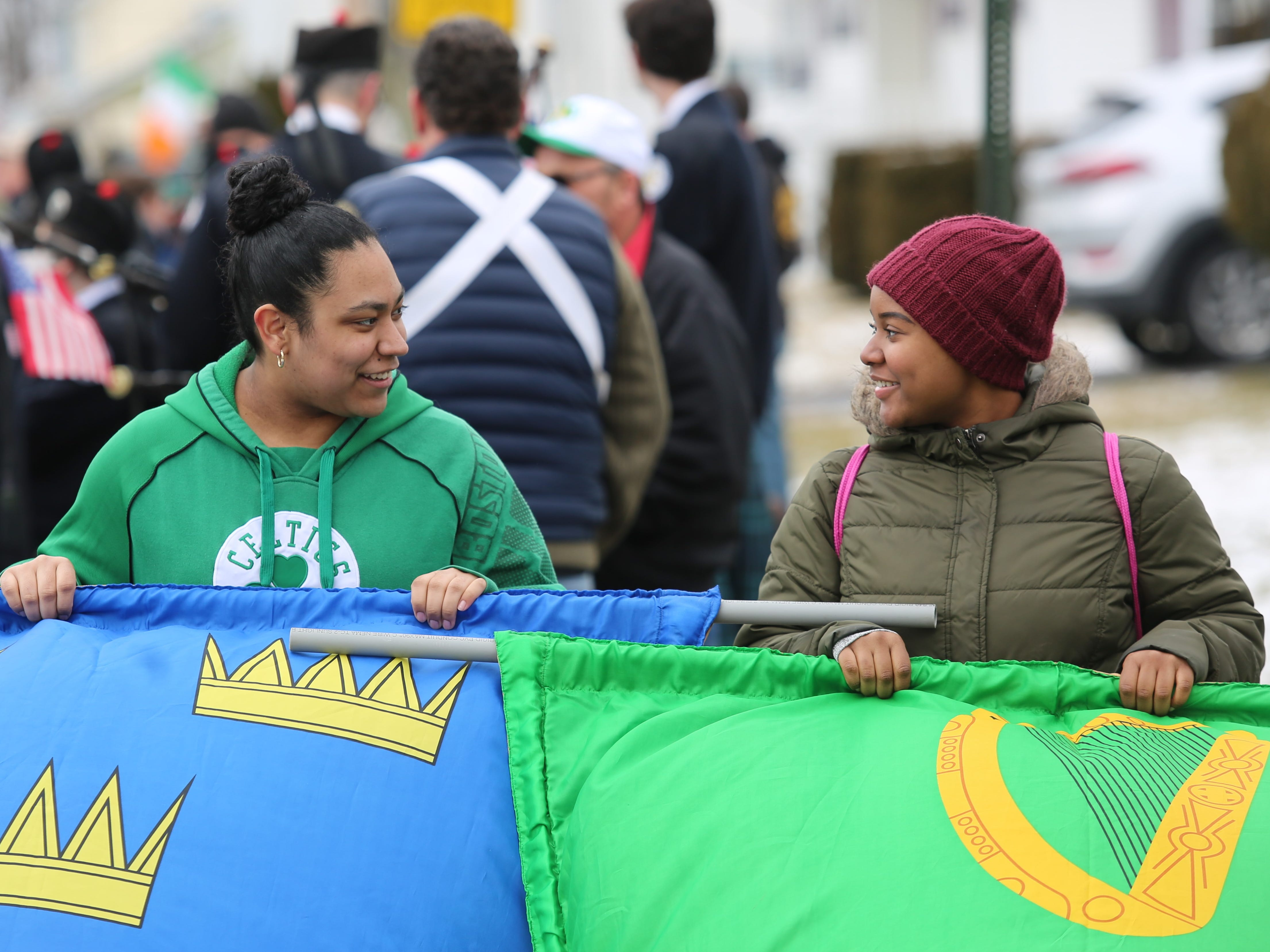 Sierra Morris (right) and Alyssa DeJesus (left), both 15-year-old students at Roy C. Ketcham High School, hold banners during the 24th annual Dutchess County St. Patrick's Day Parade held in Wappingers Falls on Saturday.