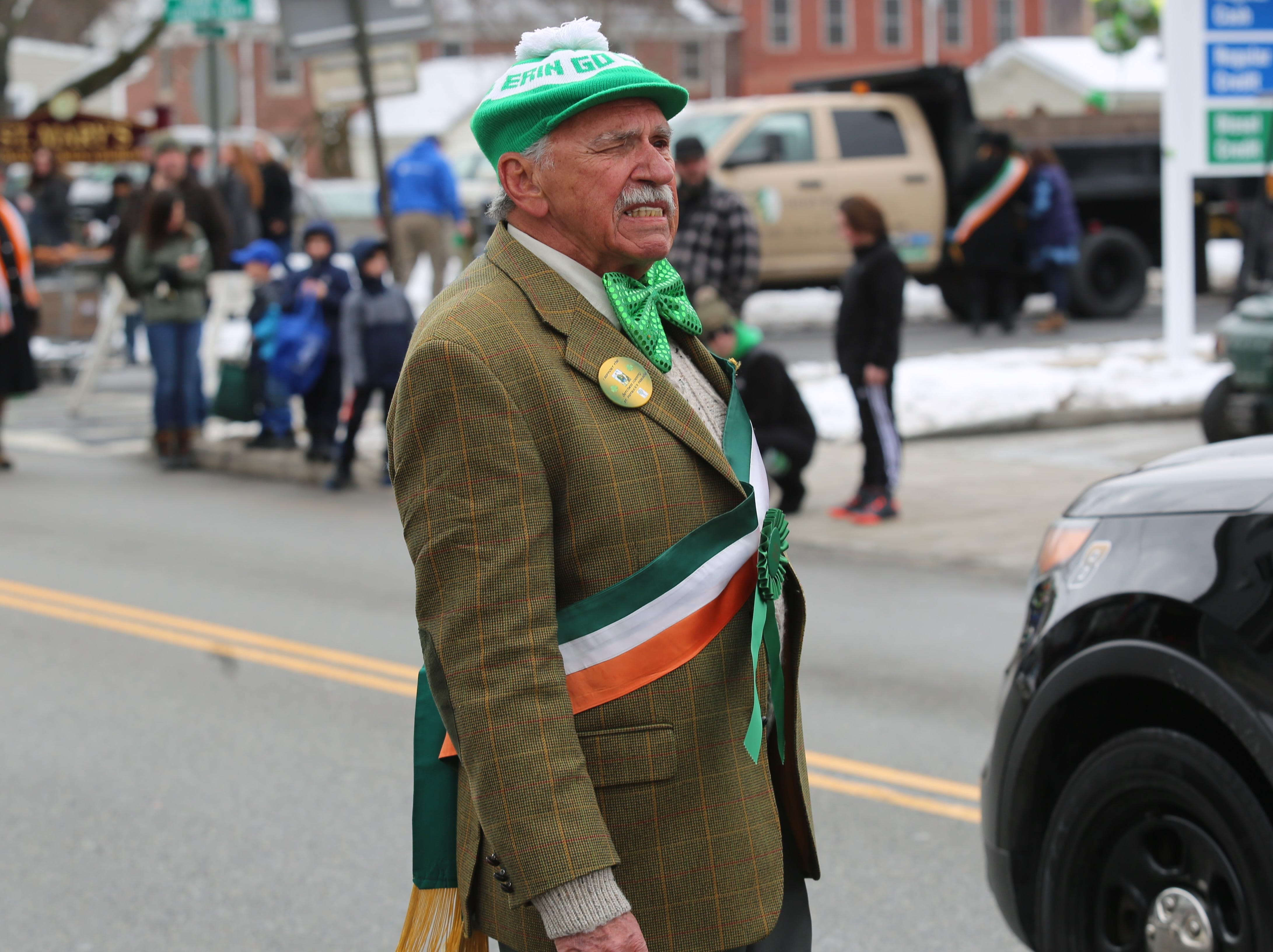 John Beale, a member of the Dutchess County St. Patrick's Day Parade Committee, stops to look at the parade as he marches in the annual celebration held on Saturday.