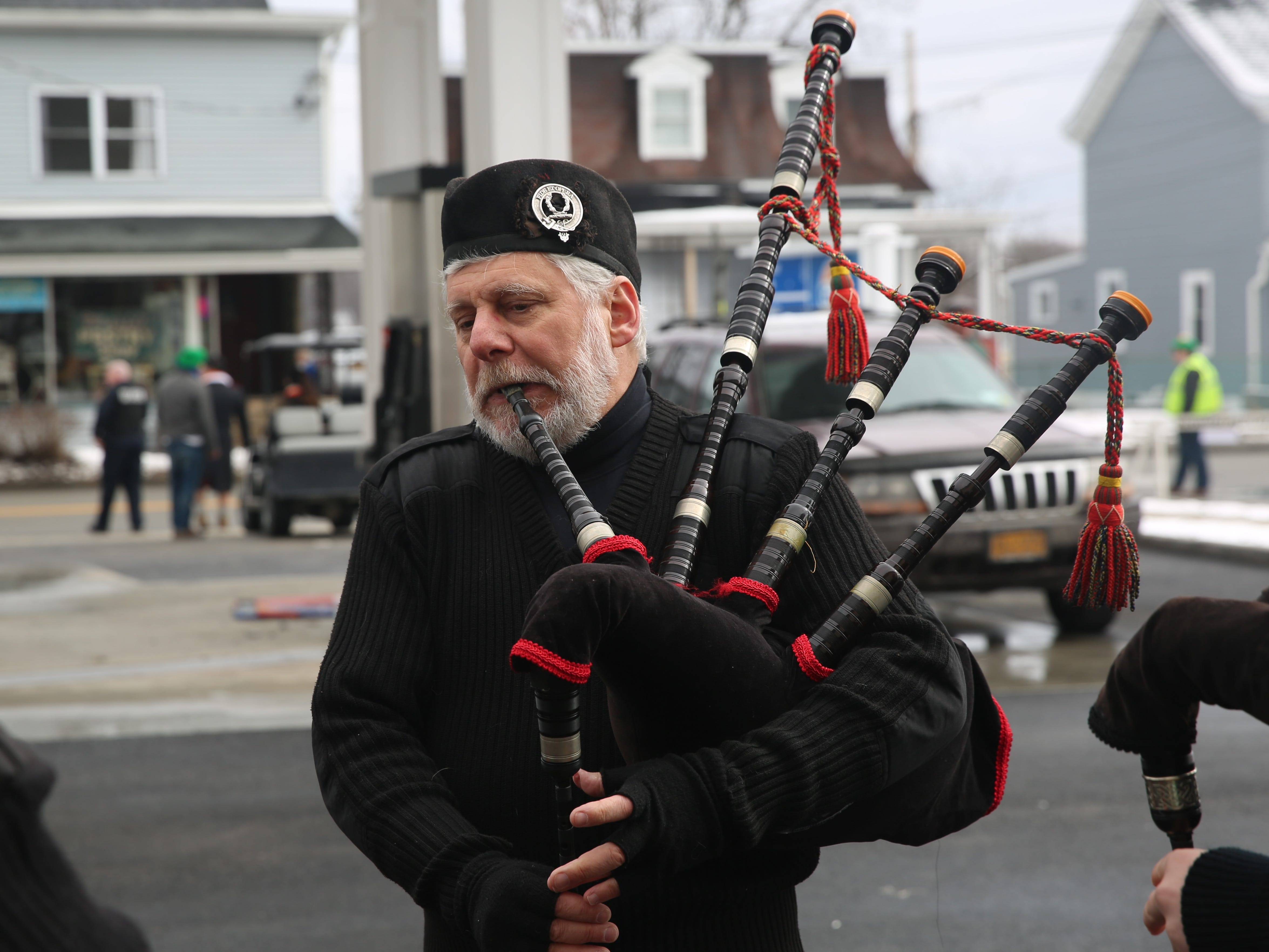 Brian Cole, of the Hudson Highlands Pipe Band, warms up before the Dutchess County St. Patrick's Day Parade begins on Saturday.