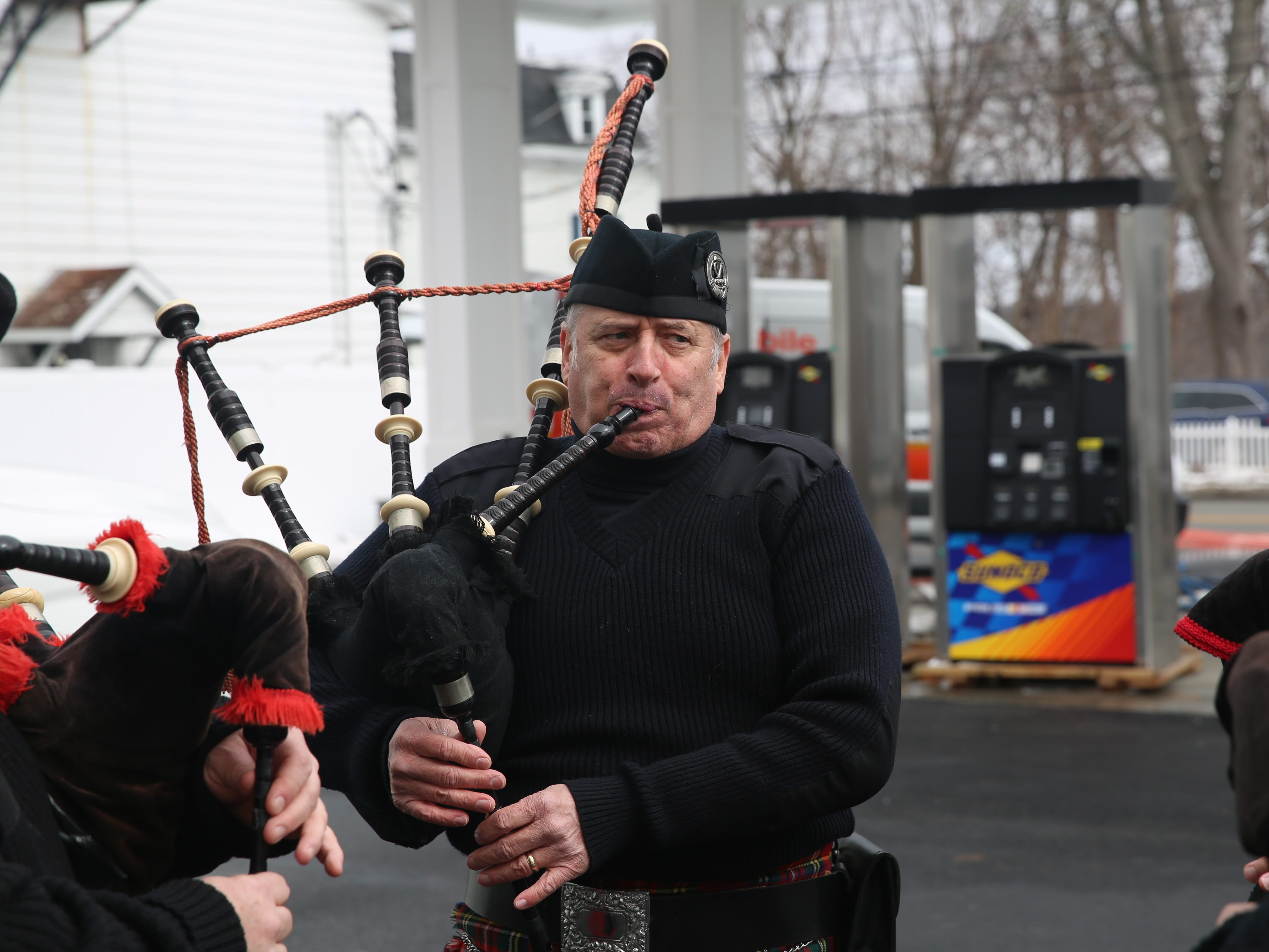 Artie Hoar, of Hudson Highlands Pipe Band, warms up before the Dutchess County St. Patrick's Day Parade begins on Saturday.