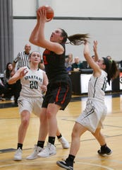 Marlboro High School's Erin Lofaro grabs a rebound between two Spackenkill players during the Section 9 Class B final at Bard College on March 2.