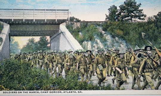 Postcard sent home by Lawrence Funk showing soldiers marching at Camp Gordon in 1917 at Camp Gordon Atlanta, Georgia