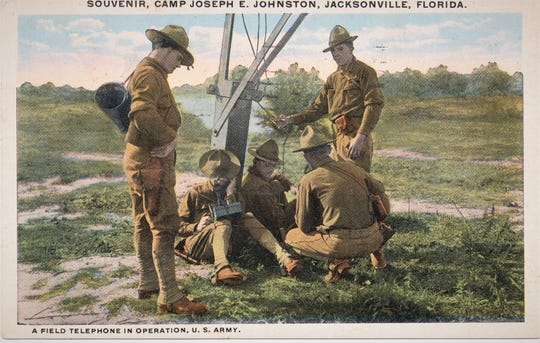 Postcard sent home by Lawrence Funk showing American soldiers training with a field telephone at Camp Johnston in 1918 at  Jacksonville,Florida