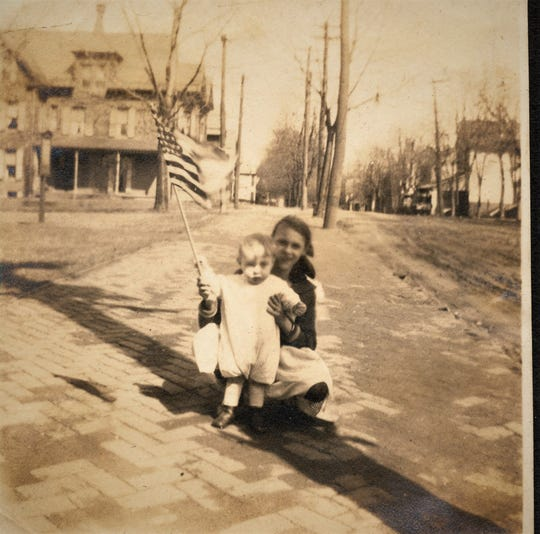 Lawrence Funk age 4 in 1900 waving American Flag with his Mother Sarah behind him in front of the Trinity Lutheran Church on Philadelphia Avenue Chambersburg.
