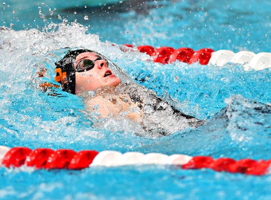York Suburban's Sophia Guyer competes in the 100 backstroke during the District 3 Swimming Championships at Cumberland Valley High School in 2019. Guyer returns for the Trojans for the 2019-2020 season.