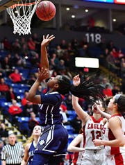 Dallastown's D'Shantae Edwards takes the ball to the basket in the Wildcats' loss to Cumberland Valley in the District 3 Class 6-A title game. Dallastown plays Downingtown East on Friday at West York High School in the first round of the PIAA tournament. Dawn J. Sagert photo