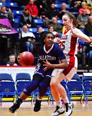 Dallastown point guard D'Shantae Edwards, left, led the Wildcats with 11 points in the team's 33-27 loss to Cumberland Valley in the District 3 Class 6-A title game. Dawn J. Sagert photo