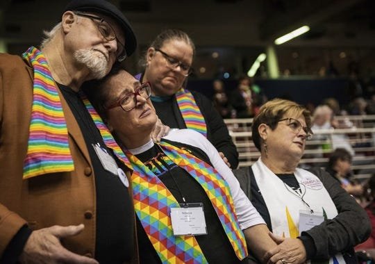 In this Feb. 26, 2019, file photo, Ed Rowe, left, Rebecca Wilson, Robin Hager and Jill Zundel, react to the defeat of a proposal that would allow LGBT clergy and same-sex marriage within the United Methodist Church at the denomination's 2019 Special Session of the General Conference in St. Louis, Mo. The church ended a pivotal conference on Feb. 26 in a seemingly irreconcilable split over same-sex marriage and the ordination of LGBT clergy.