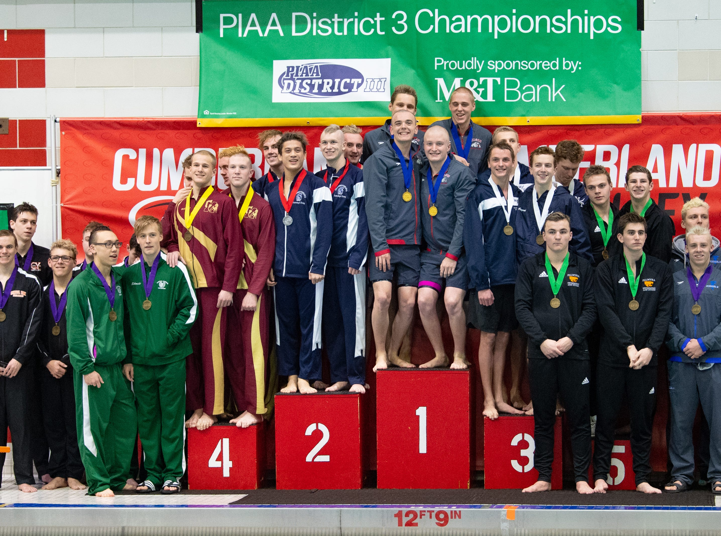 The winners of the 200 Yard Medley Relay receive their medals during the PIAA District 3 Boys AAA Championship, March 1, 2019 at Cumberland Valley High School.