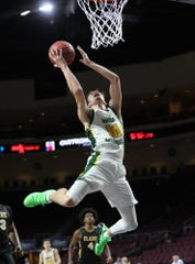 Bishop Manogue senior Kolton Frugoli  leaps toward the basket in Thursday's 4A state semifinal loss to Clark.