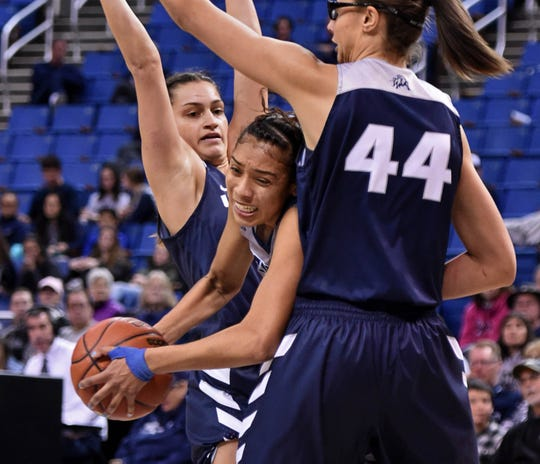 Nevada's Terae Briggs is double-teamed by Utah State's Eliza West, left, and  Deja Mason during Saturday's game at Lawlor Events Center.