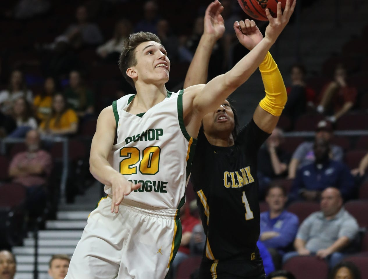 Bishop Manogue's Cort Ballinger lays up the ball against Clark in the first quarter of Thursday's 4A state semifinal game at the Orleans Arena.