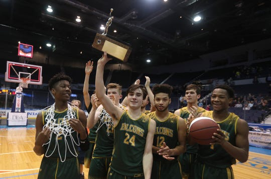 C.G. Finney's Keegan Ocorr (24) and teammates celebrate winning the Class C1 title 63-42 over Marcus Whitman.