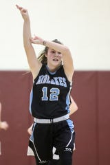 Midlakes guard Alaina Forbes (12) celebrates a three-pointer against Batavia during the Section V Class B1 girls basketball championship game. Forbes scored 35 points in the game and was named tournament MVP.