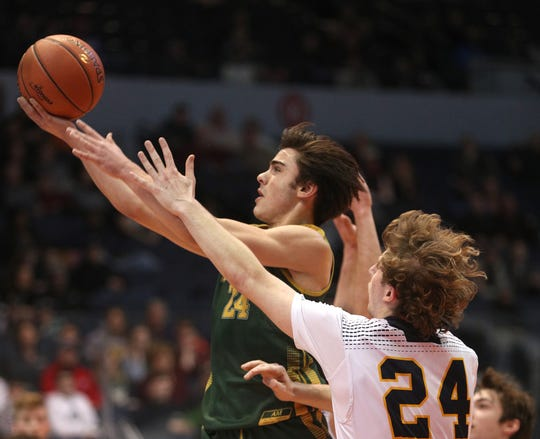 C.G.Finney's Keegan Ocorr drives to the basket against Marcus Whitman's Seth Benedict in the Class C1 final.