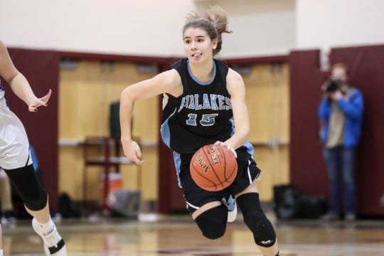 Cara Walker (15) of Midlakes dribbles with her tongue out against Batavia during the Section V Class B1 girls basketball championship game at Caledonia-Mumford on March 1, 2019.