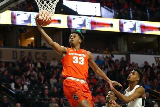 Syracuse Orange forward Elijah Hughes (33) goes up for a shot against Wake Forest forward Isaiah Mucius (1) during the second half of Syracuse's 79-54 win on Saturday.