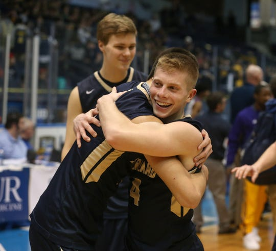 Sutherland's Matt Panara, right, hugs teammate Ben DiGiovanni as they celebrate their 53-49 win over East.