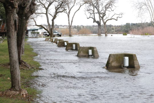 Electrical boxes sit just above the rising Sacramento River on Saturday, March 3, 2019, at the Marina RV Park in Redding. The river's rising level forced about 20 recreational vehicles to seek higher ground. The river started flooding the park's lower level when the Bureau of Reclamation started releasing more water from Shasta and Keswick dams Thursday to make room in Lake Shasta for storm runoff.