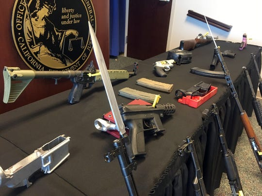 Weapons seized by state Department of Justice special agents are shown during a press conference by Attorney General Xavier Becerra Friday, March 1, 2019, in Sacramento, Calif. Becerra unveiled new numbers for 2018 Friday from a uniquely California program that seizes guns from people no longer allowed to own them because of criminal convictions or mental illness.