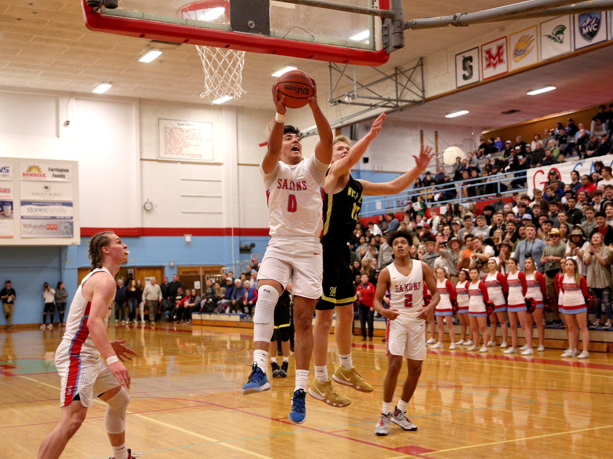 South Salem's Treyden Harris (0) rebounds the ball during the South Salem vs. West Linn boys basketball OSAA playoff game at South Salem High School on Friday, March 1, 2019.