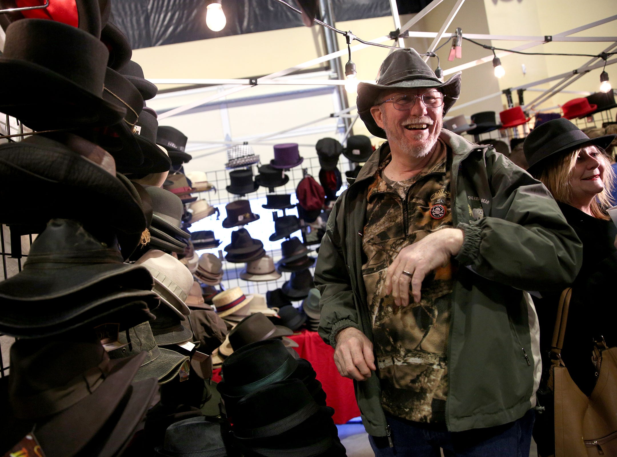 Ted Robinson, of Molalla, tries on a hat at a booth at the annual Volksfest in Mt. Angel on Saturday, March 2, 2019.