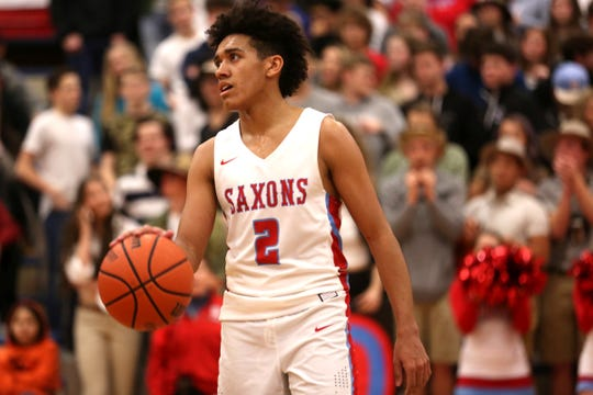 South Salem's Jaden Nielsen-Skinner (2) waits for the clock to wind down during the South Salem vs. West Linn boys basketball OSAA playoff game at South Salem High School on Friday, March 1, 2019.